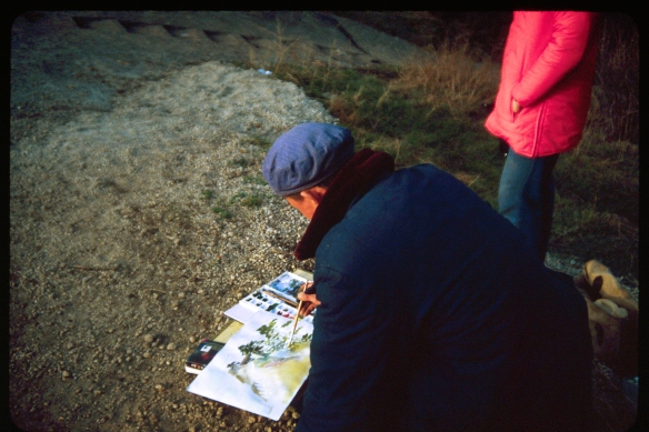 An artist paints a familiar summit building at sunset. Photo © 1982 Patti Isaacs.