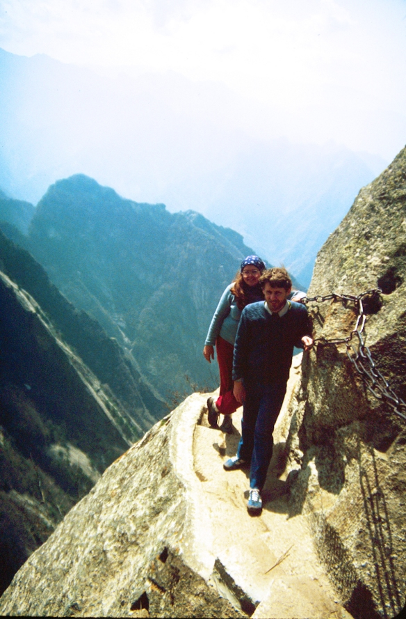 Chris Irving (foreground) and Patti Isaacs pause on a ledge on Hua Shan before walking around the corner to a hidden grotto. Photo © 1982 by Gauss Rescigno.