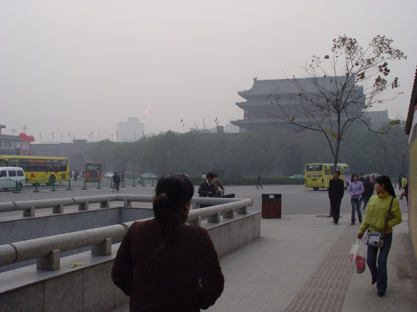A sunny day in Xi'an, November, 2005. The sun is the faint orange dot just above and to the right of the office building in the background.
