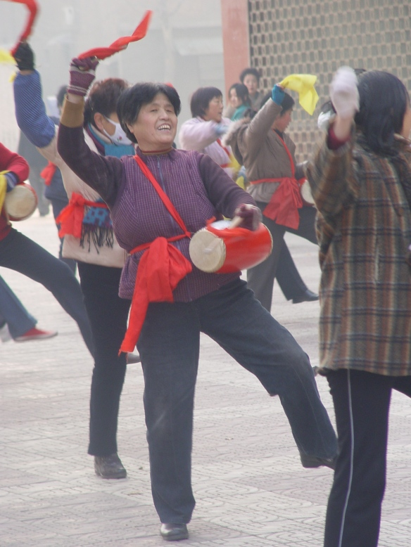 Dancing and drumming in an apartment courtyard, 2005.