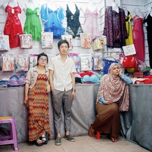 Chen Yaying and Liu Jun, who go by the names Kiki and John, in their lingerie store in Asyut, with their Egyptian assistant Rahma Medhat.Credit Photograph by Rena Effendi / INSTITUTE